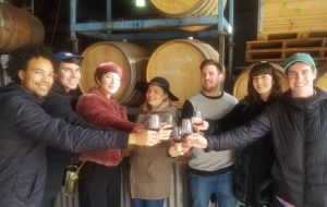 group with wine barrels